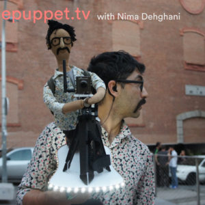 Ali's puppet is a reporter